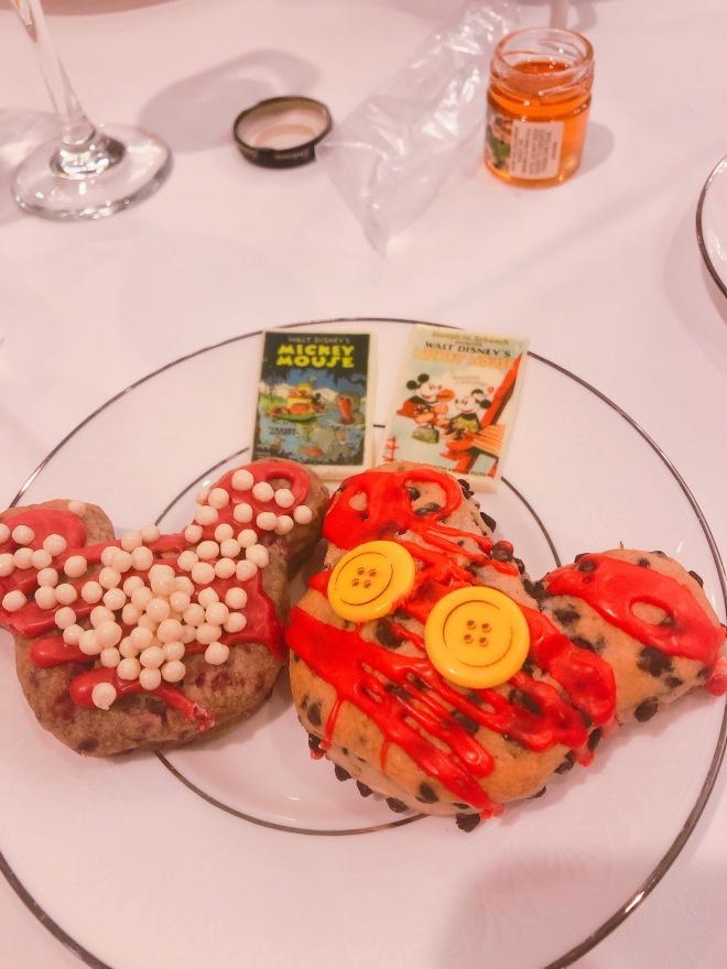A picture of the Mickey and Minnie themed scones offered at the Mickey's Tea Party Celebration. the Minnie scone was raspberry and the Mickey scone was chocolate chip.
